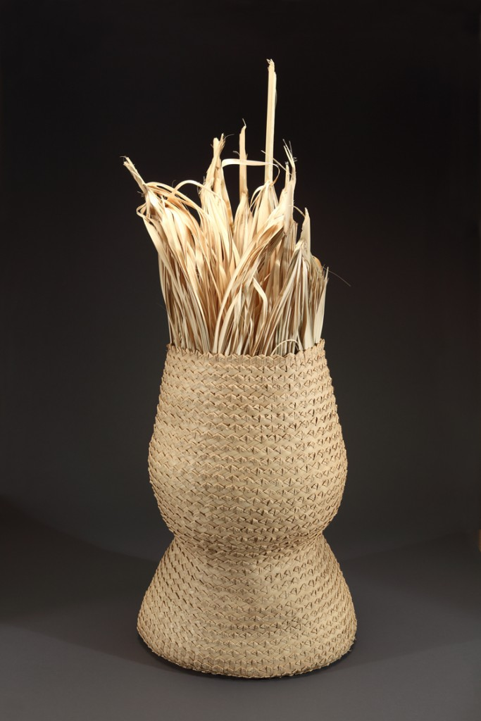 Four-strand basket, with loose palmetto leaves inside