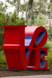 Sculpture of the word LOVE with O tilted and LO on top of VE