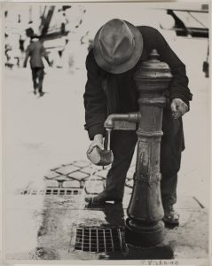 Roman Vishniac (American, born Russia, 1897–1990), Man Soaking Bread at Water Pump, c. 1938, Gelatin silver print, Image: 9 1/2 x 7 9/16 in. (24.1 x 19.2 cm); sheet: 9 13/16 x 8 in. (24.9 x 20.3 cm), Museum purchase, 74.95