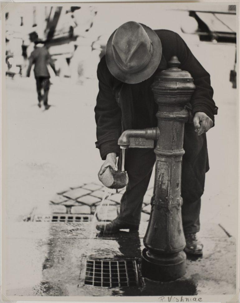 Roman Vishniac (American, born Russia, 1897–1990), Man Soaking Bread at Water Pump, c. 1938, Gelatin silver print, Image: 9 1/2 x 7 9/16 in. (24.1 x 19.2 cm); sheet: 9 13/16 x 8 in. (24.9 x 20.3 cm), Museum purchase, 74.95