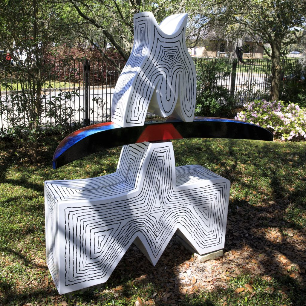 A sculpture by Ida Kohlmeyer in the Besthoff Sculpture Garden is made of abstract painted aluminum shapes.