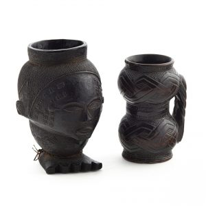 Two elaborately carved wooden palm wine cups
